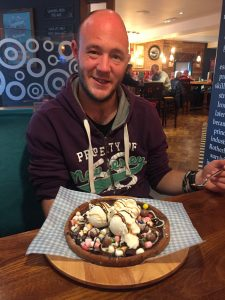 Our client David with a HUGE dessert!